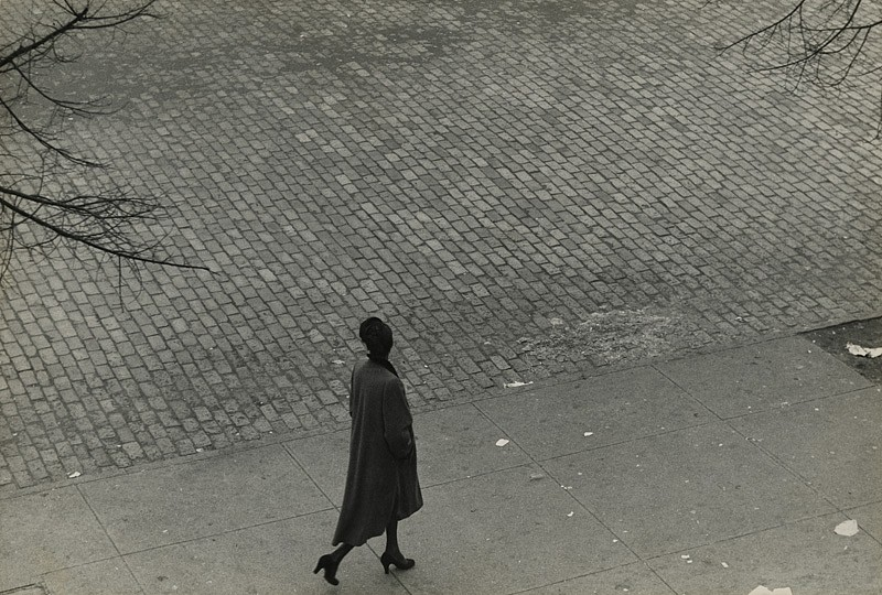 Roy DeCarava ,   Woman walking, above, New York  ,  1950     Vintage gelatin silver print ,  9 1/8 x 13 1/2 in. (23.2 x 34.3 cm)     4169     Sold